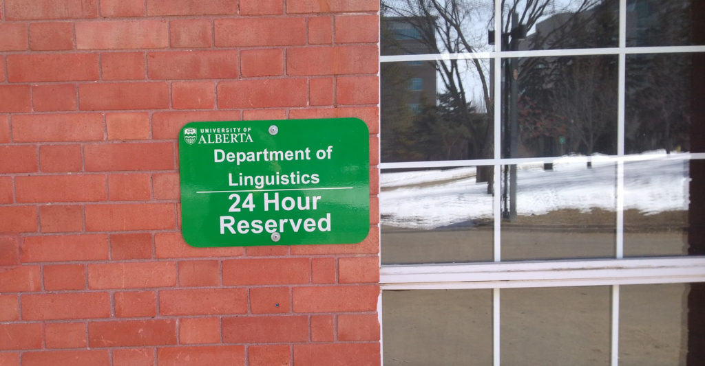 Parking stall sign for Assiniboia Hall